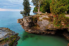 Rocky Cliffs at Cave Point royalty free stock photography