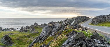 Rocky cliffs on the coast of the Barents Sea along the Varanger Tourist Route. Rocky cliffs on the coast of the Barents Sea, Varangerhalvoya National Park royalty free stock images