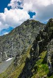 Rocky cliffs of Fagaras mountains in summertime. Beautiful nature scenery on high altitude royalty free stock photos