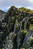 Rocky cliffs of Fagaras mountains in summertime. Beautiful nature scenery on high altitude Stock Photos