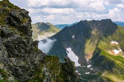 Rocky cliffs of Fagatas mountains in Romania. Beautiful summer nature scenery Royalty Free Stock Image