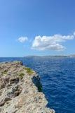Rocky cliffs of Gozo near Malta. Rocky cliffs of Gozo in blue sea near Malta Royalty Free Stock Images