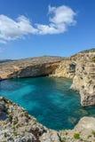 Rocky cliffs of Gozo near Malta. Rocky cliffs of Gozo in blue sea near Malta Stock Photos