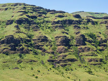 Rocky cliffs and green grass Royalty Free Stock Images