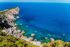 Rocky cliffs at mediterranean sea coast. Beautiful sea view coastline, vast seas royalty free stock image