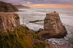 Rocky cliffs at Muriwai beach, near Auckland, New Zealand. Rocky cliffs at Muriwai beach with gannet colony, near Auckland, New Zealand royalty free stock photos