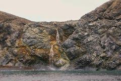 Rocky cliffs of Novaya Zemlya archipelago in Royalty Free Stock Photo
