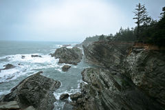 Rocky Cliffs on the Pacific Coast. Rocky cliffs along the Pacific coast of the state of Oregon in the United States. These coastal areas attract thousands of Royalty Free Stock Photography