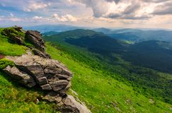 Rocky cliffs of the Pikui mountain. Borzhava mountain ridge in the far distance. Beautiful summer landscape on a cloudy day stock image