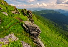Rocky cliffs of the Pikui mountain. Borzhava mountain ridge in the far distance. Beautiful summer landscape on a cloudy day royalty free stock photo