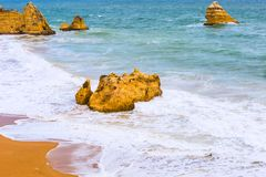 Rocky cliffs of Praia Dona Ana at Lagos, Portugal Stock Image