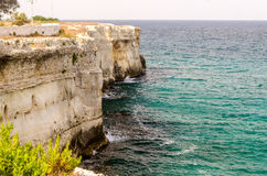 Rocky cliffs at Torre dell'Orso town in Salento, Italy Royalty Free Stock Photo