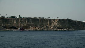 Rocky cliffs at tourist resort in Egypt. Tourist resort in Egypt, traveling on the sea, sightseeing animals and sunken ships stock video footage