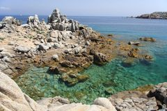 Rocky coast. Wild rocky coast and crystal water in the north of Sardinia Stock Images