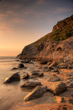 Rocky coast. Sunset at Lusty beach in Newquay, Cornwall, UK royalty free stock image