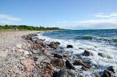 Rocky coast. Coast with rocks and a small house Royalty Free Stock Photo