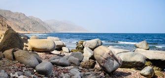 Rocky coast. Spread out stones on the rocky coast Royalty Free Stock Photos