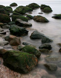 Rocky Coast. Rocks and Sand along coast in water royalty free stock images
