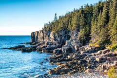 Rocky coast of Acadia national park. Morning light shines on boulder beach along the rocky coast in Acadia national park stock photography