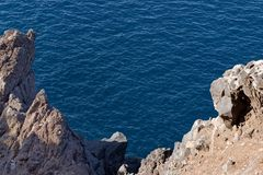 Rocky coast against blue water of Atlantic ocean. On Portuguese island of Madeira stock photo
