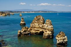 Rocky coast of the Algarve near Lagos Stock Images