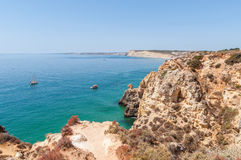 Rocky coast of Algarve in Portugal Royalty Free Stock Photos