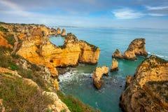 Rocky coast Algarve southern Portugal. Rocky coastline  Algarve southern Portugal Royalty Free Stock Images