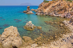 Rocky coast, Ammoudaraki, Milos island, Greece Royalty Free Stock Photo