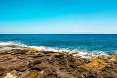 Rocky coast with azure water, Malta. EU Stock Images