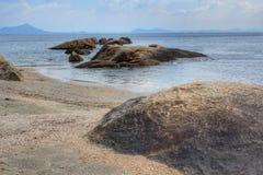 Rocky coast on the beach Stock Photos