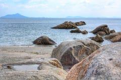 Rocky coast on the beach Stock Photo