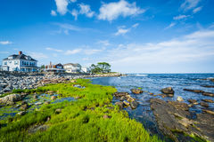 Rocky coast and beachfront homes at Concord Point, in Rye, New H Stock Image