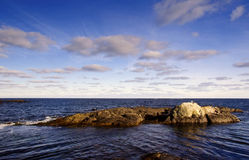 Rocky Coast and Beautiful Clouds Royalty Free Stock Photography