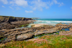 Rocky coast blue sea and sky Newtrain Bay North Cornwall near Padstow and Newquay Stock Images