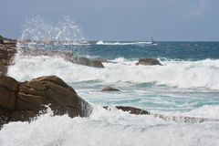 Rocky coast of Brittany with big breakers Stock Images