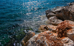 Rocky coast and calm sea surface, copy-space Stock Photo