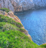 Rocky coast in Capo Caccia in hdr Stock Photography