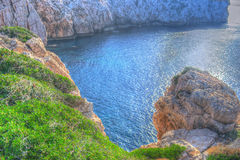 Rocky coast in Capo Caccia in hdr Royalty Free Stock Photography