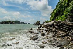 Rocky coast of Cat Ba Island royalty free stock photos