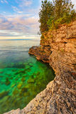 Rocky Coast at Cave Point. The rocky coast of Door County, Wisconsin's Cave Point displays vivid colors just after sunrise Stock Image