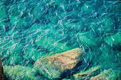 Rocky coast with clean blue see-through water. Cinque Terre Royalty Free Stock Images