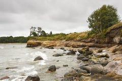 Rocky coast and a cliff Stock Photos