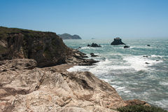 Rocky Coast. Cliiffs along the coast with large rocks in the ocean Royalty Free Stock Images