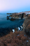 The rocky coast of the cold winter morning. Stock Image