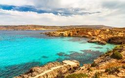 Rocky coast of the Comino island. Rocky coast of the Comino island between the islands of Malta and Gozo in the Mediterranean Sea, Europe Stock Image