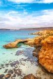 Rocky coast of the Comino island. Rocky coast of the Comino island between the islands of Malta and Gozo in the Mediterranean Sea, Europe Royalty Free Stock Photos
