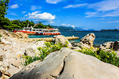 Rocky coast Croatia. Croatia, peninsula Peljesac and resort Orebic. Rocks, turquoise sea and boats royalty free stock photos