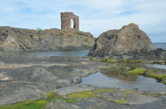 Rocky Coast at elie. A view of an old Victorian era stone tower on the Elie coast Royalty Free Stock Image