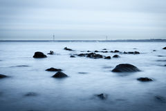 Rocky coast in the evening. Long exposure shot Stock Photo