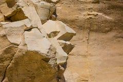 Rocky coast formed by sandy sediments. Rocky coast formed by sandy sediments and sandstone cliffs. Marsaskala on the coast of the Malta island in the Royalty Free Stock Photo